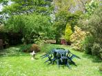 Dine Alfresco in this beautiful garden with mature trees and shrubs