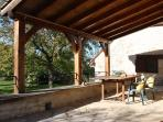 The sunny terrace has a roof for those who prefer some shade in mid-summer.