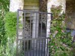 Access to the garden from the terrace via a stone spiral staircase