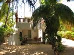 Frontview of Villa set in a tropical garden.