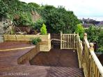 The terraced garden, with fabulous sea views across Heysham beach & Morcambe bay to the hills be