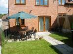 Rear Garden with patio area, Large Garden Table, 10 Garden Chairs, Children's Picnic Table, Barbecue