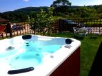 The Hot tub has views of the hills, fantastic when a star lit night!