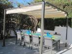 Covered pergola with table and chairs for al-fresco dining on the west facing BBQ Deck