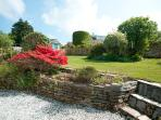 Sunny, enclosed rear garden with plenty of lawn and borders - ideal for hide & seek!