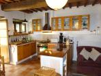Ergonomic kitchen area, with oven, gas top, built in fridge and quality equipment