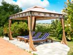 Gazebo with wooden loungers with matresses