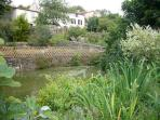 The river runs along the back garden - perfect for fishing