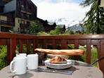 Apartment 26 breakfast on the balcony at Vallandry in Summer