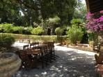 Shady and full of Mediterranean plants, enjoy your meal under the big Carrubbo