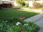 Ramey private garden showing lawn and decking