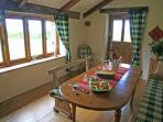 The dining room enjoys views of the open country leading onto your patio area with garden furniture.