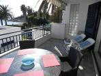 Terrace with bay view, space for large dining table and sun loungers. Wind out awning.