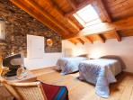 Attic bedroom with original stone wall.
