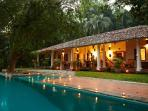 The main villa at dusk- sleeps 9 guests