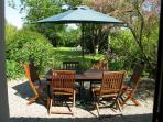 The garden terrace with dining table and chairs for at-home relaxation!