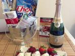Snacks await our guests as well as a bottle of champagne and chocolate covered strawberries!