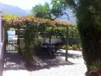 private shaded garden leading to pool