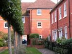 The apartment at Charter Court overlooks an attractively landscaped courtyard at the rear