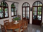 Part of dining room showing french doors to patio