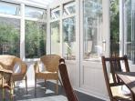 heated conservatory, with glass roof, slate floor and views to mountains