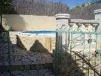 Double locking security gate leading to the pool area