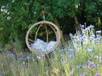 Swing chair in the garden shade