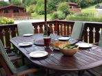 Al-fresco dining on the front decking served from our gas bbq