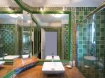 bathroom, the lavatory is separate and next to the bathroom on the right