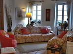 Lovely sunny sitting room, looking on to the picturesque Rue du Suquet.