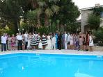 A wedding group photo by the pool at the Villa.