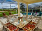 Dine outside under our covered lanai with ceiling fan