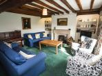 The sitting room sits 8 in comfort with plenty of firewood available.