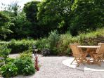 Garden, with seating area and BBQ.