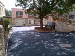 The drive way down to the Old Workshop which is the 2nd on the right, behind the oak tree