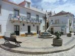 Pretty cobbled village square