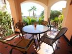 The patio is a great place for a sunshine breakfast and overlooks the pool and gardens.