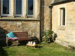 Carefully placed bench in the front garden to catch the morning sun with your cuppa and a good book.