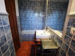 En suite bathroom has bath and  shower over it.There's a massive mirror ideal for admiring your tan.