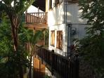 private entrance to the apartment, accessible through a private garden with stone steps and path