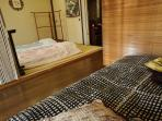 the tatami room with futon (japanese matress ) and the sofa bed room dived by the accordion curtain
