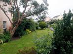 The well kept front garden provides a pretty outlook onto the cul-de-sac
