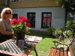 Owner relaxing in the private lower rustic courtyard