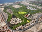 Overview of the apartment, golf course and shopping center located on the waterfront.