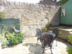 Rear patio garden, a real sun trap, ideal for barbeque's