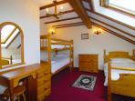 Saddlers Cottage has a set of full size bunk beds and a single bed in the second bedroom.