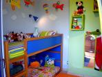 Colorful kids` bunk bedroom at ground level