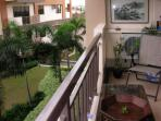 Balcony overlooking foregarden and poolside in distance...