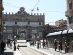 What do you see from the windows! Behind the arch you are in Piazza del Popolo!