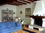 The living room... comfortable seating, TV and a traditional charentaise fire